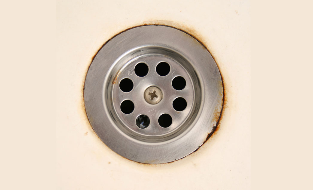 What are the Reddish Brown Stains in My Sink, Tub and Toilet?